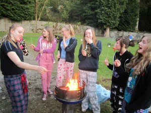 Guides toasting marshmallows